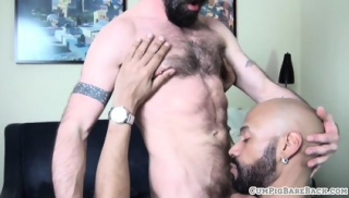 Mature hunk sucking hard cock on his knees