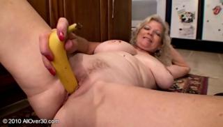 Mature Woman Plays With Banana