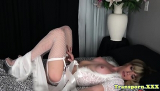 Busty blonde trap shows big tits and jerks