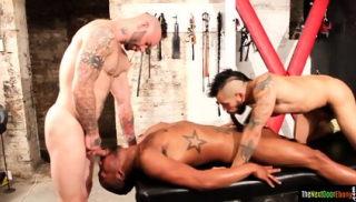 Muscly black hunk spitroasted by white studs